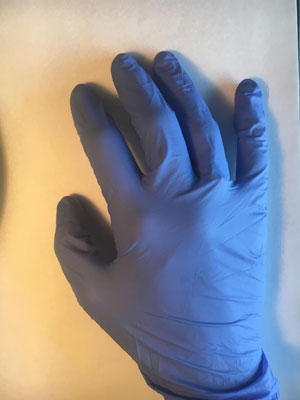 rubber glove on hand
