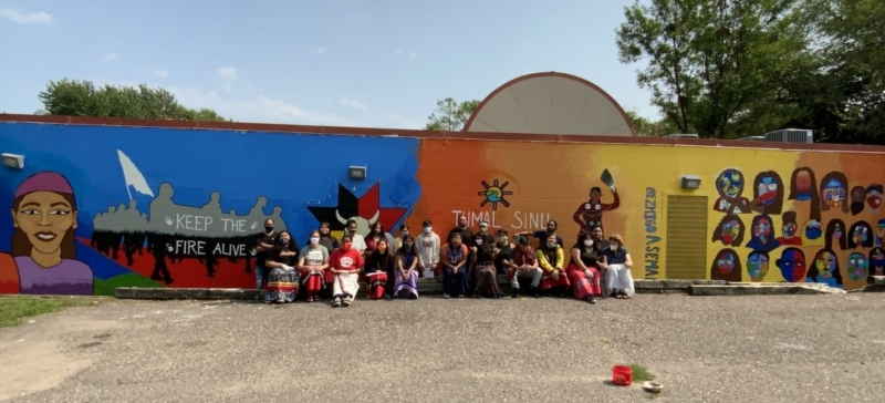 Youth from Ikidowin Youth Theater Ensemble in front of the mural they painted
